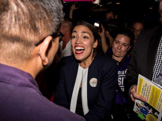Progressive challenger Alexandria Ocasio-Cortez celebrartes